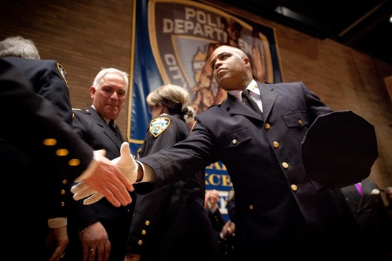 Newly appointed Chief of Department Philip Banks III shakes hands at an NYPD promotion ceremony  Photo: https://blogs.wsj.com