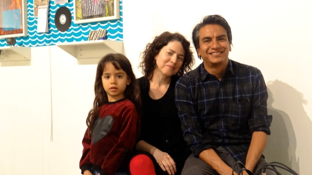 """Valerie Tevere (center) and Angel Nevarez (right) with their daughter at BRIC Media Art House where they hosted """"Another Protest Song Karaoke"""""""