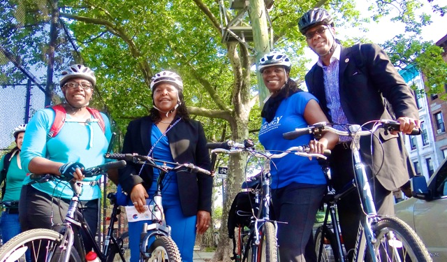"""City Councilmember Robert E. Cornegy (far right), his wife and his staff gear up for a """"Bike to Work"""" trip across the Williamsburg Bridge (l to r) Dynishal Gross, Legislative Director; Steffani Zimmerman, Communications Director; and Michelle Cornegy, wife of Robert E. Cornegy, Jr."""