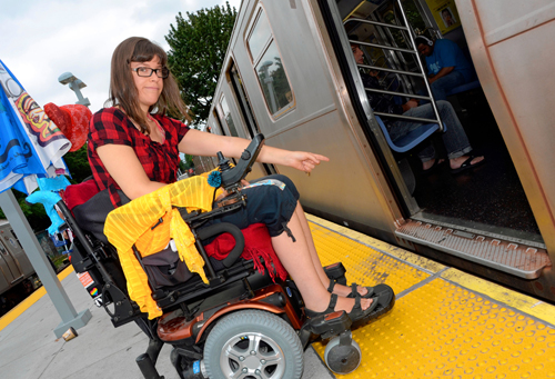 Michele Kaplan is frustrated and often struggles in her wheelchair to get over the large gap between the train car and the platform. Photo: Elizabeth Graham