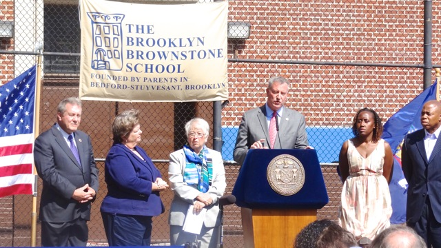 (l to r) New York City Council Chair Daniel Dromm, New York State Assembly Chair of the Education Committee Cathy Nolan, NYC Schools Chancellor Carmen Farina, Mayor Bill de Blasio, Brooklyn Brownstone School Principal Nakia Haskins and Brooklyn Borough President Eric Adams at the Mayor's press conference announcing student gains on 2014 test scores
