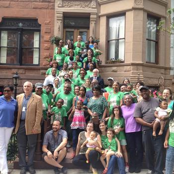 Macon Street residents celebrate their block winning the 2014 Greenest Block in the Borough contest.  (Photo Courtesy Gothamist)