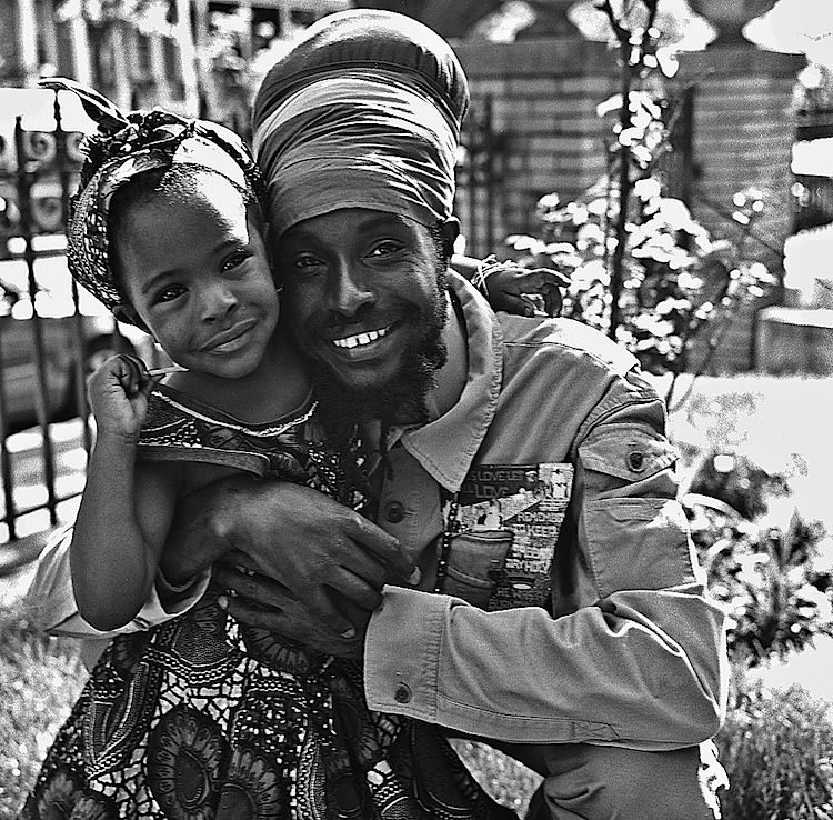 Spring, 2014 -- King Lion Boboshanti and his daughter Queen Omenga pose for a portrait at a Mother's day event at the Akawabaa Mansion in Bed Stuy. King Lion is a Vegan raw food chef from Jamaica. Photo: Russell Frederick