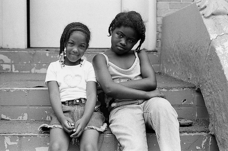 Summer, 2003 -- Two friends pose for a picture on Throop Ave right before they are told to come upstairs. Photo: Russell Frederick