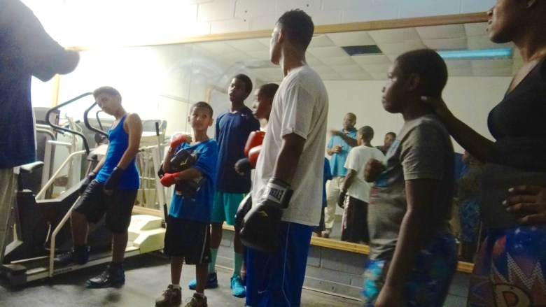 """Lorenzo Steele talking to a group of youth at the Bed-Stuy Boxing Gym. He pulls them aside for 30 minutes each day and discusses """"Life Skills,"""" and the importance of education"""