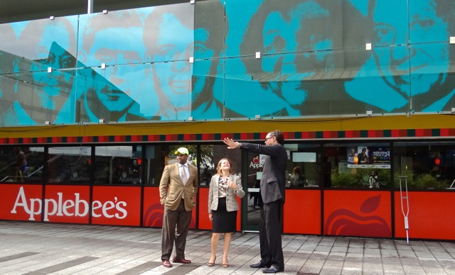 City Council Speaker Melissa Mark-Viverito (second from left) is accompanied by City Councilmember Robert Cornegy, Jr. and Michael Lambert, executive director of the BID end their tour of Fulton Street at Restoration Plaza