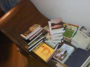"""The books by my bed, many of which were used as research for my newest play, """"Extreme Whether"""""""