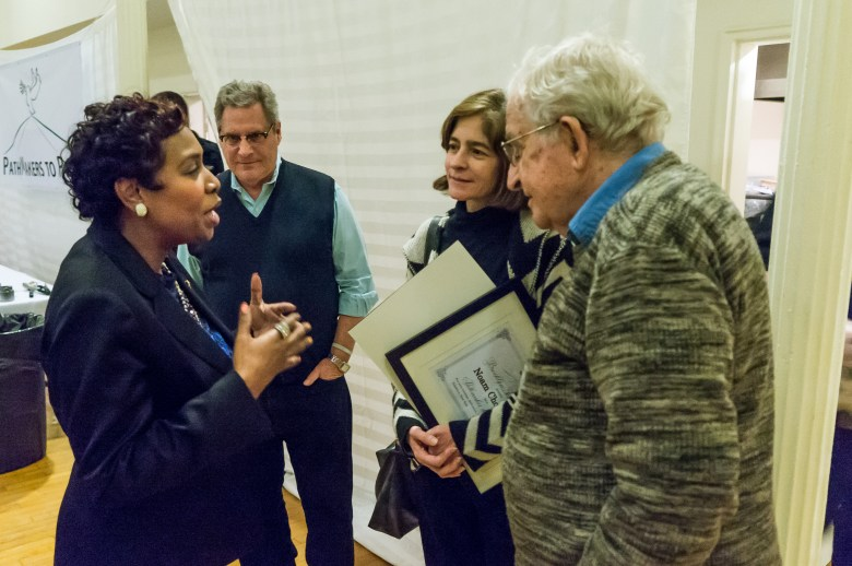 Congress Member Yvette Clarke chats with Noam Chomsky after his speech. BFP's Eric Shtob looks on along with Valeria Wasserman Chomsky.