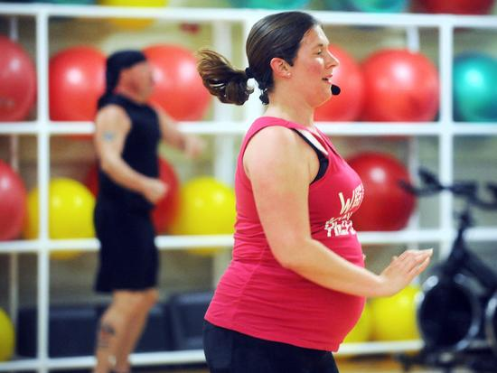 Lawyer balances fitness instruction with work, parenting and pregnancy