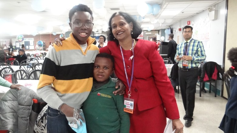 Dr. Kusum Viswanathan, Chair of the Department of Pediatrics and the Director of the Division of Pediatric Hematology/Oncology at Brookdale Hospital with a former patient and his sibling