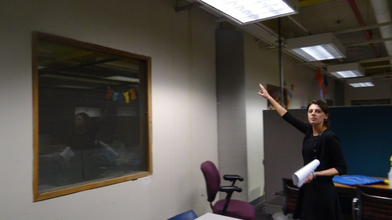 Brooklyn Children's Museum President Stephanie Wilchfort points to some water damage on one side of the afterschool room (Note: Children are kept away from this side of the room)