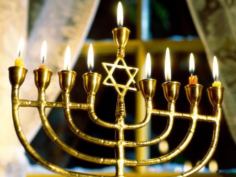 """Hanukkah is the Jewish eight-day, wintertime """"festival of lights,"""" celebrated with a nightly menorah lighting, special prayers and fried foods."""