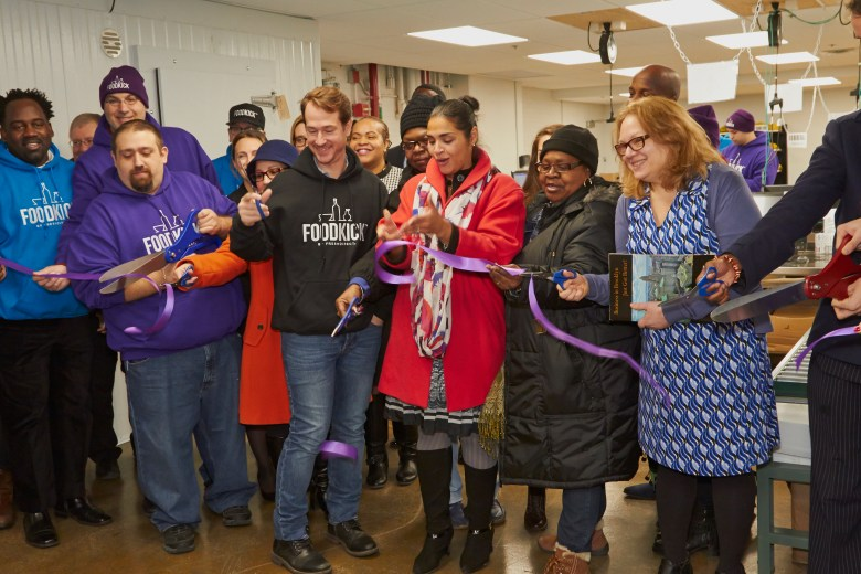 FreshDirect co-founder and CEO Jason Ackerman and  Deputy Brooklyn Borough President Diana Reyna (center) are joined by FoodKick staff as well as Brooklyn community partners for a ribbon cutting celebrating the launch of the new on-demand food business