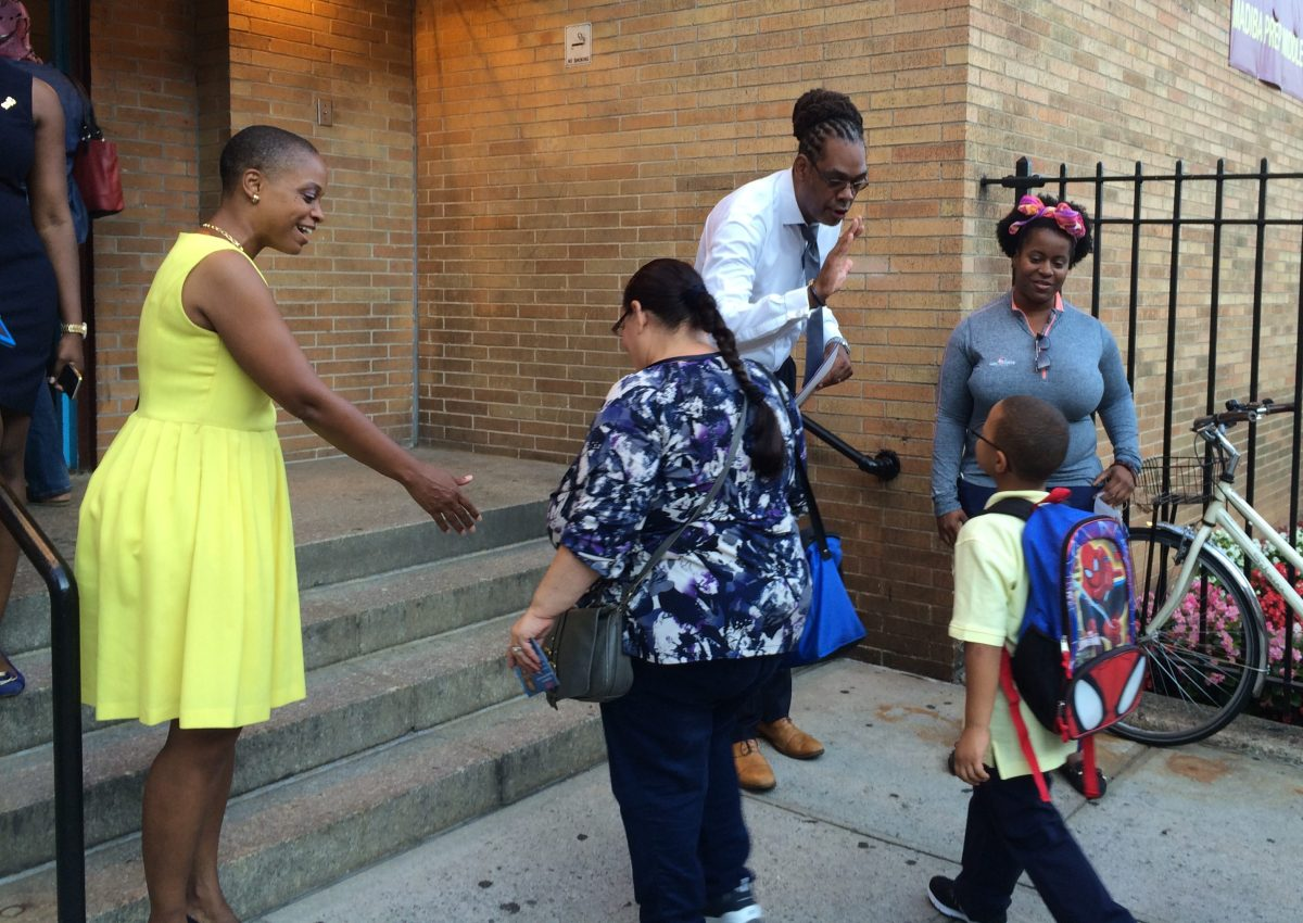 Students at P.S. 26 arrived greeted with high-fives on their first day of school