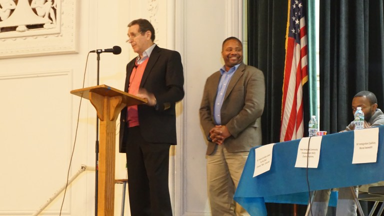 Senator Jesse Hamilton is introduced by moderator Norman Siegel, a prominent civil rights lawyer