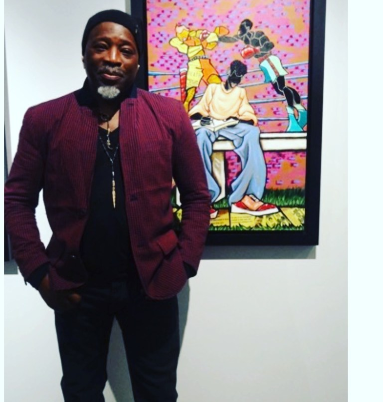 """Leroy Campbell stands in front of one of his portraits for the exhibit """"The Fight Continues"""" at the Richard Beavers Gallery."""