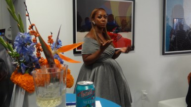 Christa Lynch, founder of Brooklyn Braised, addresses residents at her new business launch