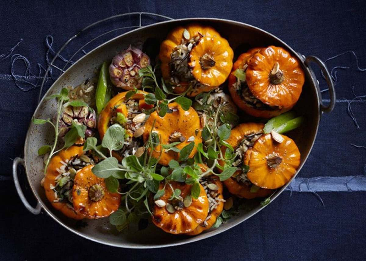 Tender young pumpkin stuffed with wild rice and cranberries makes for a fun and tasty dish.