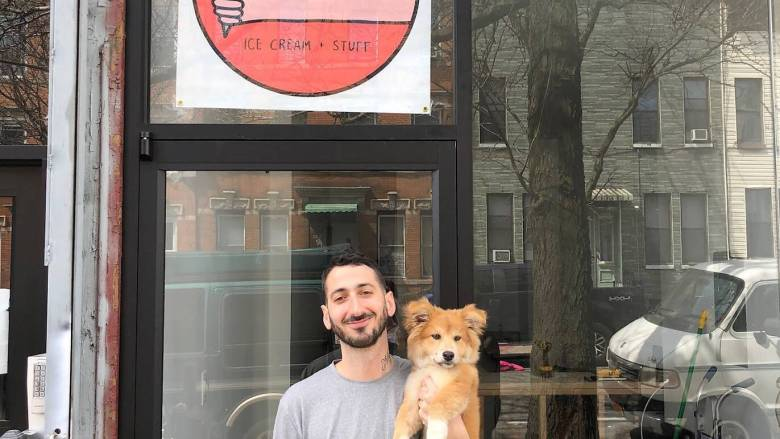 Eric Kyriakopoulos and his main paw-pal Simon in front of the soon-to be open Ollie's Ice Cream & Stuff.