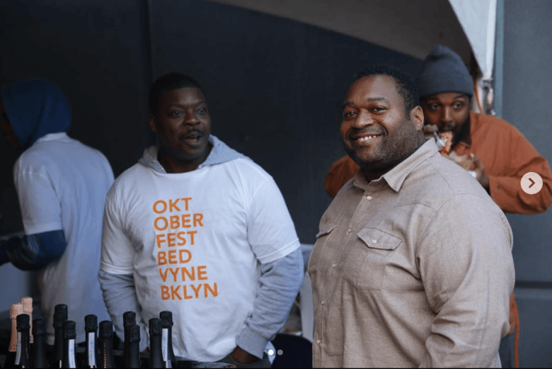 Bed-Vyne owner Michael Brooks, on the right, smiles at 2018's Oktoberfest