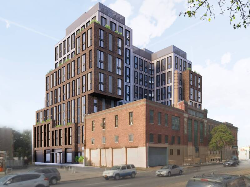 The Landmarks Preservation Commission approved a proposal that would replace two buildings and a parking lot on the site of the former dairy factory