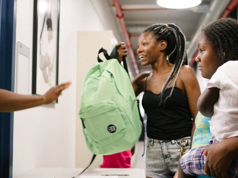 During the community gathering, the organization gave out 100 free backpacks filled with school supplies to local elementary and high school students.