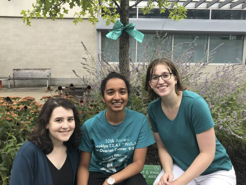 Advocates tied teal-colored ribbons on trees along Myrtle Avenue Plaza to raise awareness ahead of September's National Ovarian Cancer Awareness Month.