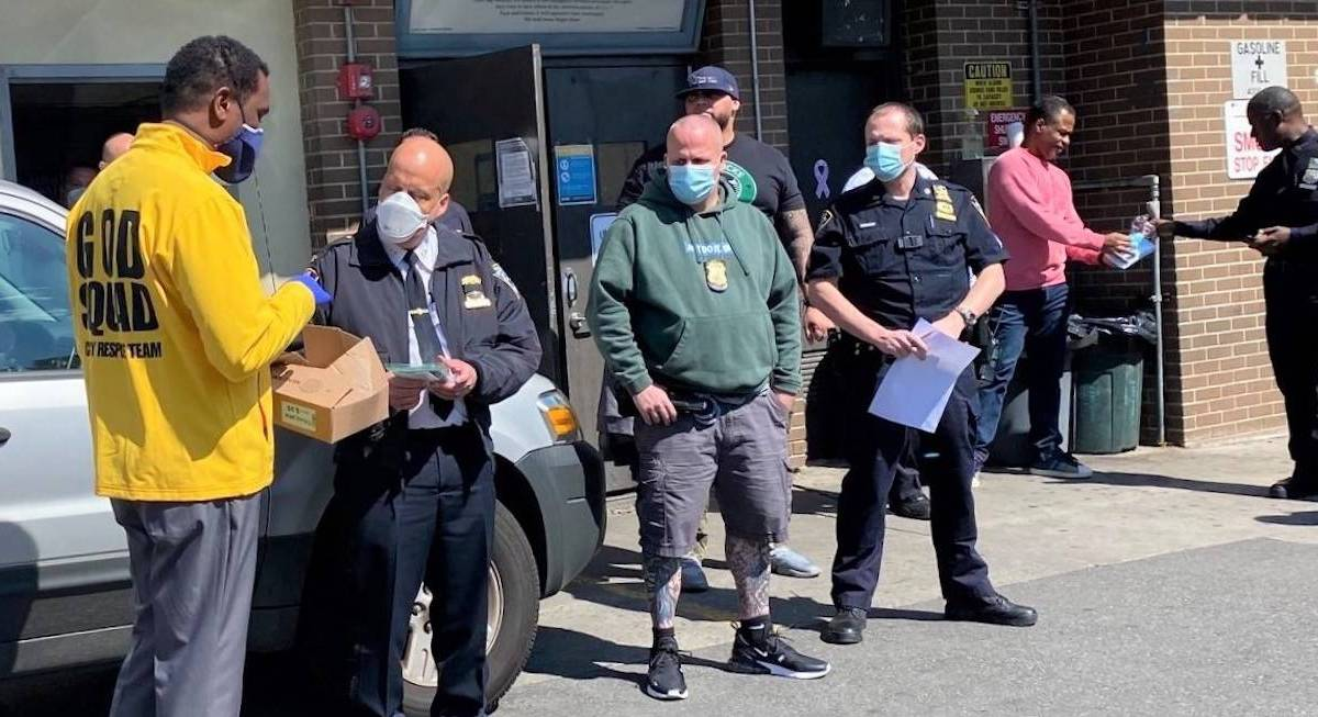 Officers at the 67th precinct receive masks from 5MMASK and the 67th Precinct Clergy Council Inc. Photo: Zam Barrett.