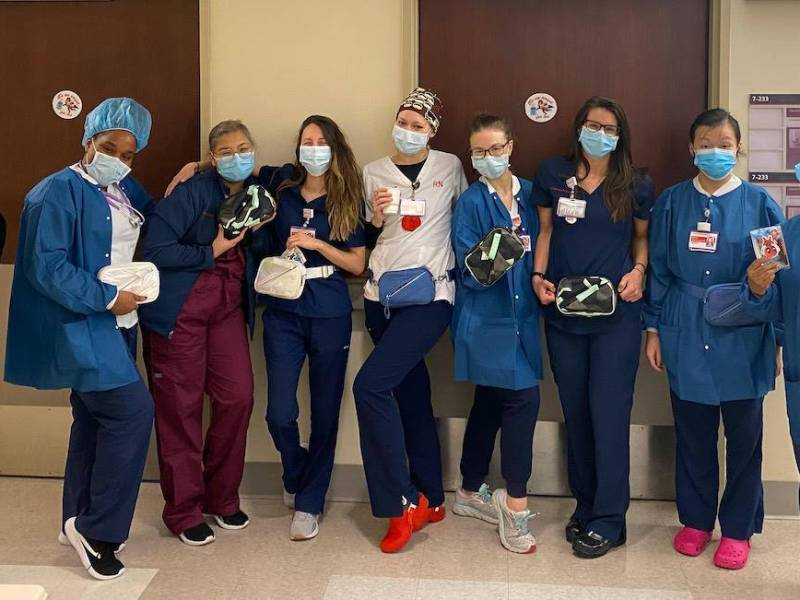 Healthcare workers model the Go Dash Dot bags donated to them. Photo: Hannah Fastov.