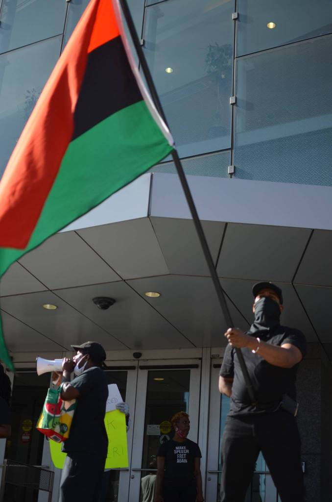 Protesters rally in front of Medgar Evers College