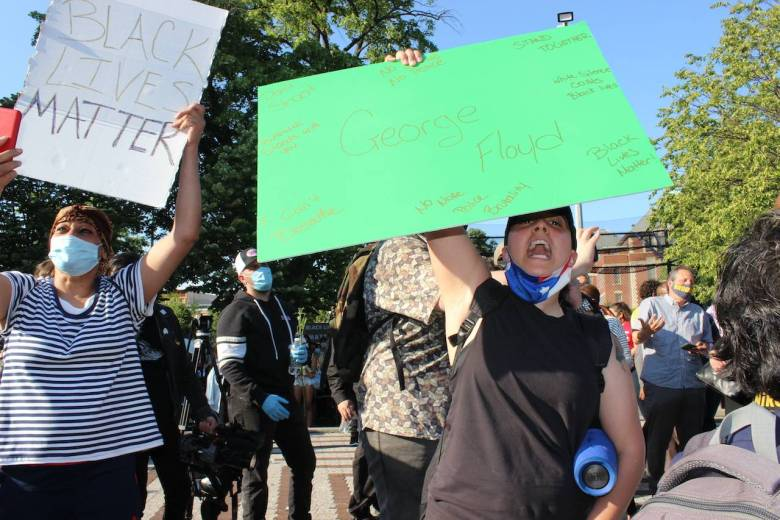 """Kayla Vargas leads the crowd yelling """"say his name"""". Photo: Anna Bradley-Smith for BK Reader."""