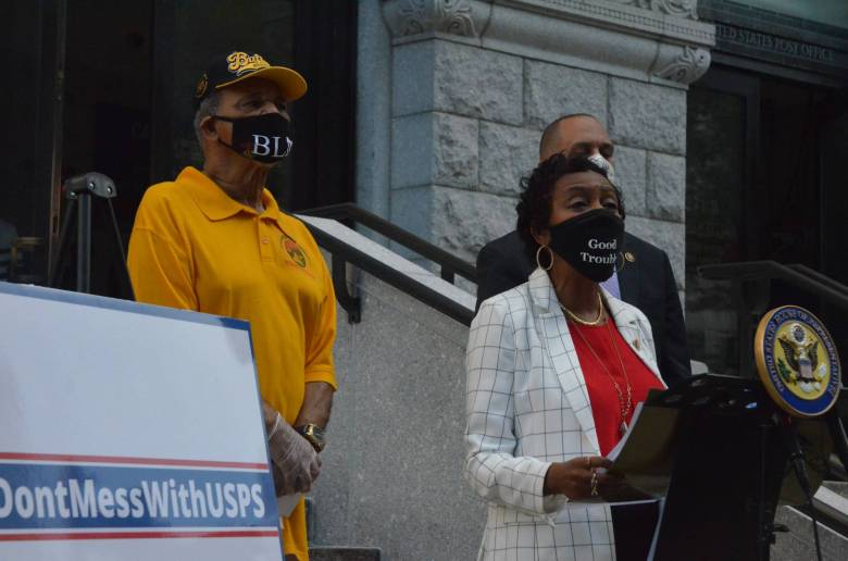 Rep. Yvette Clarke in front of the post office at Cadman Plaza