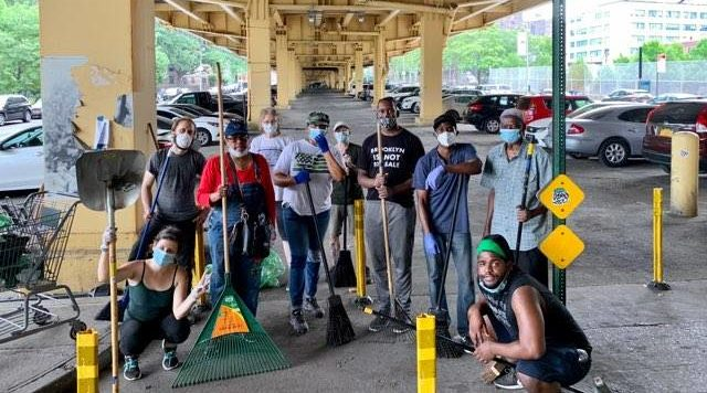 A crew of good samaritans cleaning up Fort Greene. Their group has met four times so far. Photo: Courtesy of Emese Ilyes.