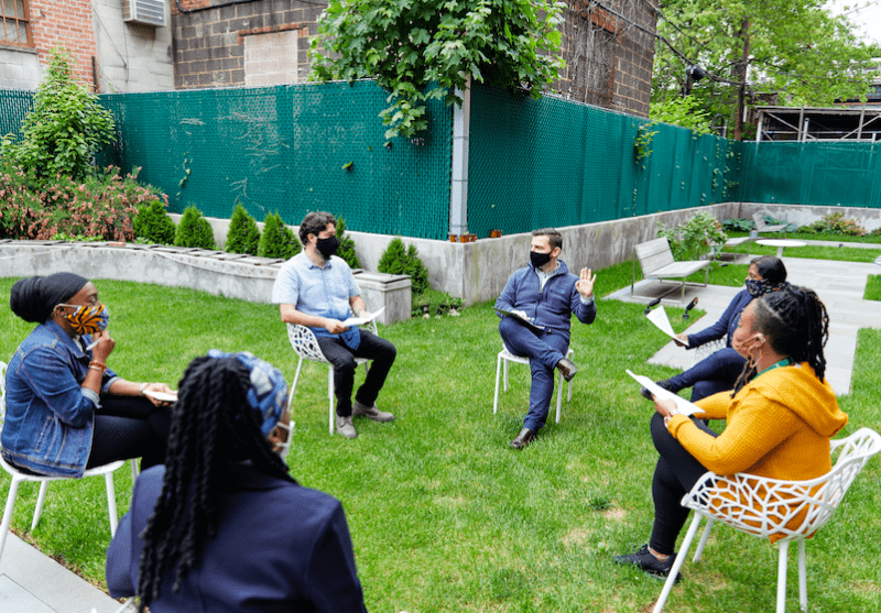 Outdoor meeting of ICL staff, including staff members from ICL Connects. Photo: Courtesy of the ICL for the BK Reader.