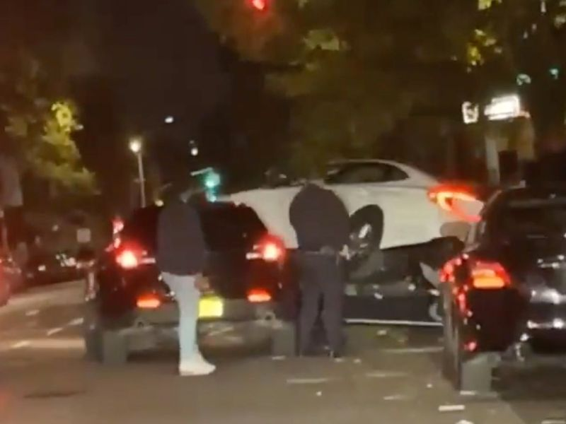 Daredevil motorist drives on top of NYPD car to escape arrest in Brooklyn: VIDEO