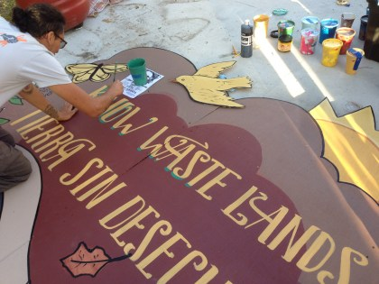 Raul hand-lettering the sign