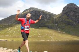 A runner crosses the causeway during the Great Wilderness Challenge.