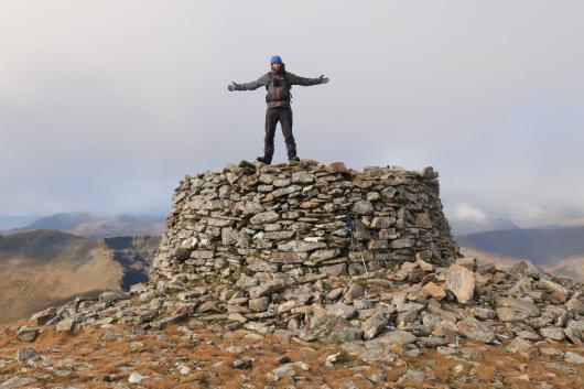 John Davidson on top of the summit cairn on Mam Sodhail.