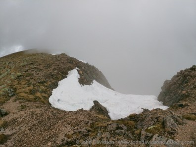 Snow hangs in the crags at the top of the Garbh Coire.