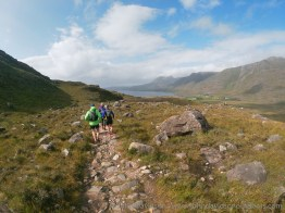Heading down towards Upper Loch Torridon with Beinn Alligin and Liathach clearing of cloud.
