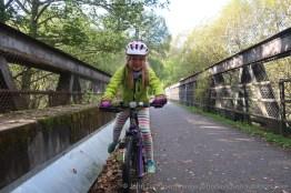 Clara heads across the old Spey bridge in Aviemore.
