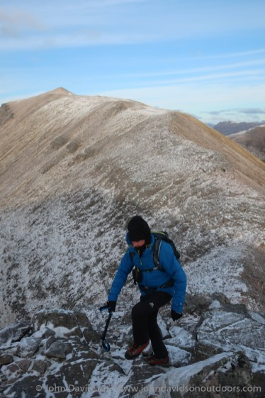 Peter heads up the rocks on the way to the east top of Coinneach Mhor, with Ruadh-stac Mor behind.