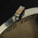 A tiny device on the edge of a coin