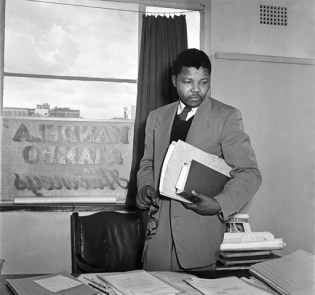 Anti-apartheid activist and lawyer Nelson Mandela in the office of Mandela and Tambo, a law practice set up in Johannesburg by Mandela and Oliver Tambo to provide free or affordable legal representation to blacks. (Photo by Jurgen Schadeberg/Getty Images)
