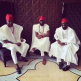 "Yoruba men in thier ""agbada"" the over coat, the ""buba and shokoto"" and ""fila"" which is the head cap"
