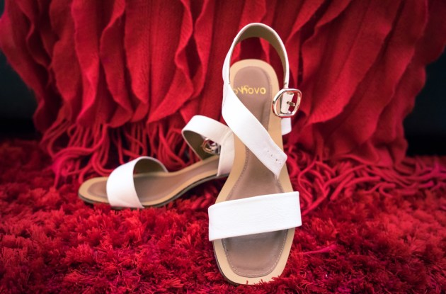 white wedding shoes detailed image in hot red colour textured background
