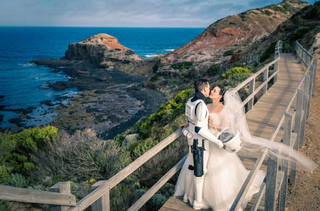 bride groom photography showing storm trooper kissing bride on bridge boardwalk of Mornington Peninsula lighthouse Victoria Australia