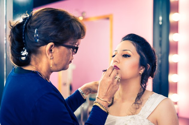 professional makeup artist put lipstick on bride to be in Glen Waverley Melbourne