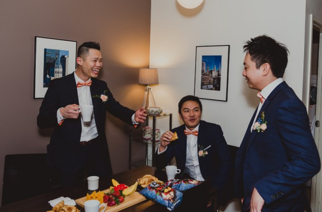 groom and groomsmen having a fun time at their Richmond home