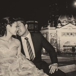 bride groom portrait kissing in front of Flinders Street Station by Black Avenue Productions